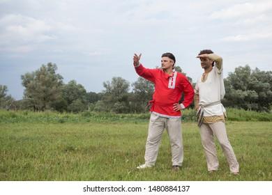 Malaya Sytkovo village, Volokolamsk region/ Russia 06 22 2019: Young men wearing Russian traditional clothing at Kupala pagan restoration festival