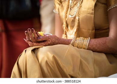 Malayalee bride at a wedding ceremony holding flowers