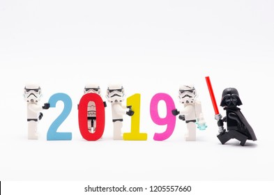 MALAYSIA, apr 06, 2018. mini figure of  storm troopers assembling year 2019 with darth vader watching them. Lego minifigures are manufactured by The Lego Group.