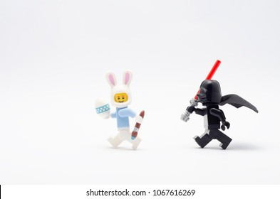 MALAYSIA, April 05, 2018. mini figure of darth vader chasing easter bunny suit guy. Lego minifigures are manufactured by The Lego Group.