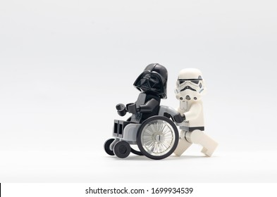 Malaysia, april 11, 2020. darth vader on wheelchair with storm trooper pushing it.  Lego minifigures are manufactured by The Lego.