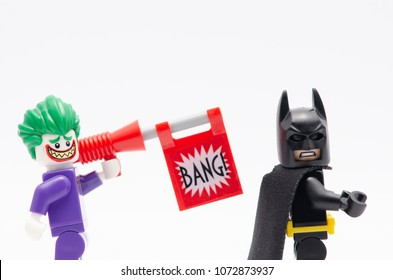 MALAYSIA, April 14, 2018. mini figure of a joker with bang gun and batman. Lego minifigures are manufactured by The Lego Group.