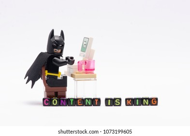 MALAYSIA, April 14, 2018. mini figure of batman on chair with word content is king. Lego minifigures are manufactured by The Lego Group.