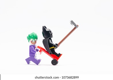 MALAYSIA, April 14, 2018. mini figure of joker pushing trolley with batman standing on it and taking picture together. Lego minifigures are manufactured by The Lego Group.