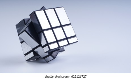 Malaysia, April 17 2017- Colourful Rubik's cubes on white background. Solving difficult IQ quiz tasks. Selective focus.
