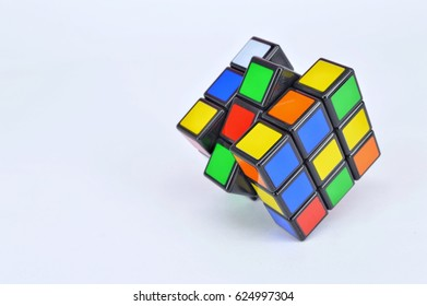 Malaysia April 20 2017,  colourful Rubik's cubes on white background. Solving difficult IQ quiz tasks.Rubik's Cube invented by a Hungarian architect Erno Rubik in 1974.(selective focus)