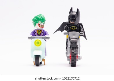 MALAYSIA, April 22, 2018. mini figure of batman and joker riding motorcycle. Lego minifigures are manufactured by The Lego Group.