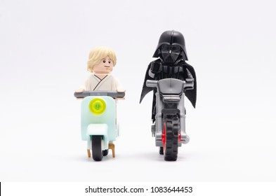 MALAYSIA, April 22, 2018. mini figure of darth vader give a direction to luke skywalker riding motorcycle. Lego minifigures are manufactured by The Lego Group.