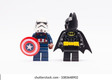MALAYSIA, April 22, 2018. mini figure of  captain america wearing storm trooper helmet with batman standing beside watching. Lego minifigures are manufactured by The Lego Group.