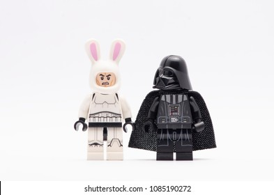 MALAYSIA, April 22, 2018. mini figure of  storm trooper wearing bunny helmet with darth vader watching. Lego minifigures are manufactured by The Lego Group.