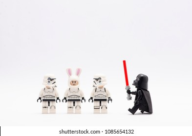 MALAYSIA, April 22, 2018. mini figure of  darth vader watching storm trooper in line with one of them wearing bunny helmet . Lego minifigures are manufactured by The Lego Group.