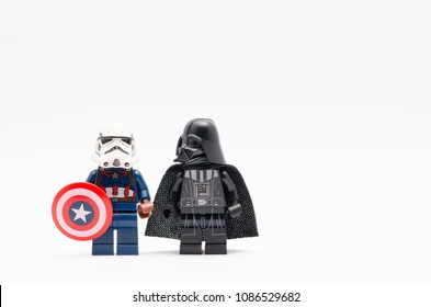 MALAYSIA, April 22, 2018. mini figure of  captain america wearing storm trooper helmet holding a shield with darth vader watching. Lego minifigures are manufactured by The Lego Group.