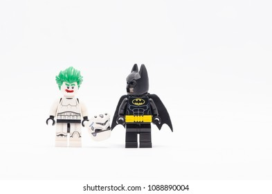 MALAYSIA, April 22, 2018. mini figure of  batman watching  joker in storm trooper suit . Lego minifigures are manufactured by The Lego Group.