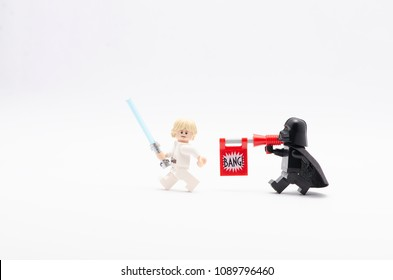 MALAYSIA, April 22, 2018. mini figure of  darth vader  with bang gun aiming shot to luke skywalker . Lego minifigures are manufactured by The Lego Group.