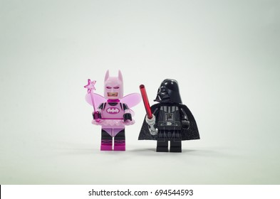 malaysia, aug 09, 2017. lego darth vader looking weird at fairy batman with vignette effect. Lego minifigures are manufactured by The Lego Group.