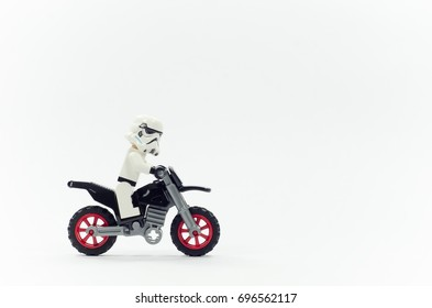 malaysia, aug 09, 2017. lego storm trooper riding dirt bike on white background. Lego minifigures are manufactured by The Lego Group.