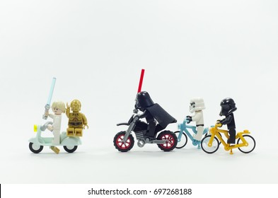 malaysia, aug 11, 2017. lego darth vader and storm troopers chasing luke skywalker and c3p0 robot.  Lego minifigures are manufactured by The Lego Group.