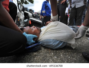 MALAYSIA, August 2017 - Medical assistants treat the victims of road accidents at Kuala Lumpur. (selective focus)
