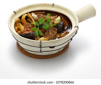 malaysia bak kut teh, traditional chinese herbal pork ribs soup isolated on white background