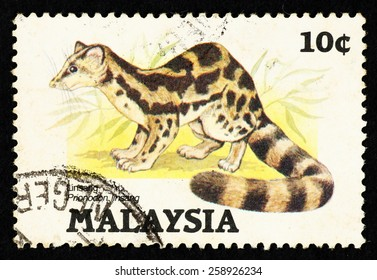 MALAYSIA - CIRCA 1985: Postage stamp printed in Malaysia with image of a Banded Linsang (Prionodon linsang).