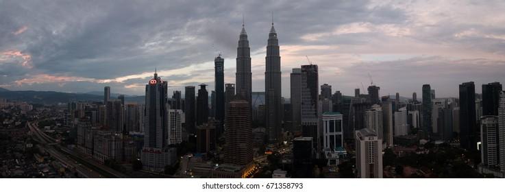 Malaysia, Circa 2017 - Aerial Panorama of Petronas Towers, Kuala Lumpur at sunrise. It is the tallest twin towers in world.