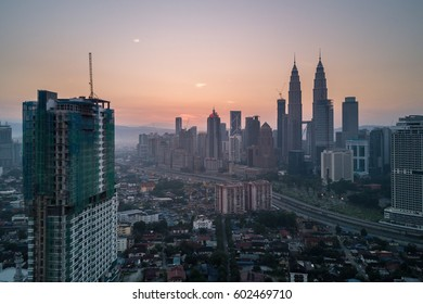 Malaysia, Circa 2017 - Aerial photo of Kuala Lumpur at sunrise with Petronas Towers visible. The twin towers used to be the highest tower in the world
