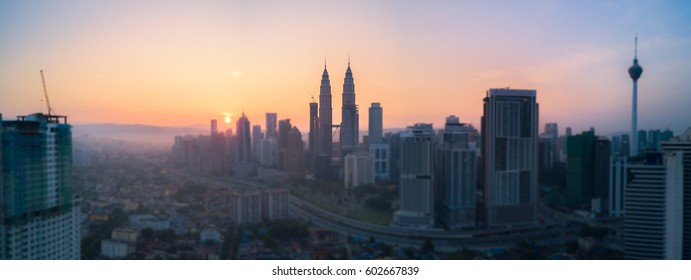Malaysia, Circa 2017 - Aerial Photo - Kuala Lumpur city at sunrise, Selective Focus and Tilt Shift effect. Petronas Towers used to be the tallest building in the world.
