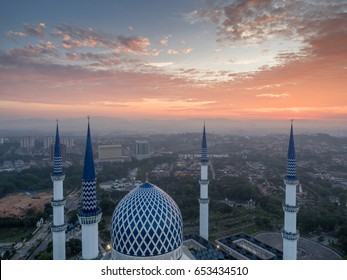 Malaysia, Circa 2017 Aerial photo of beautiful Mosque with sunset/sunrise on background