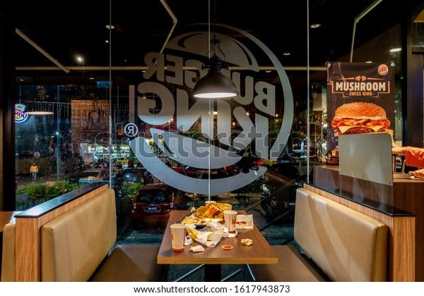 Malaysia, Circa 2019: Dirty table Burger King restaurant in Kuala Lumpur. Burger King is an American global chain of hamburger fast food restaurants.