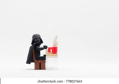 malaysia , DEC 13, 2017. darth vader sitting in front computer working. Lego minifigures are manufactured by The Lego Group.