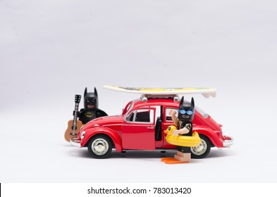 malaysia, DEC 18, 2017. vacation batman and batman going on holiday riding volkswagen beetle. Lego minifigures are manufactured by The Lego Group.