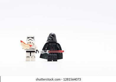 Malaysia, dec 30, 2017. darth vader watching storm trooper holding hotdog.  Lego minifigures are manufactured by The Lego.
