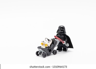 Malaysia, dec 30, 2017. darth vader pushing stroller with baby trooper in it.  Lego minifigures are manufactured by The Lego.