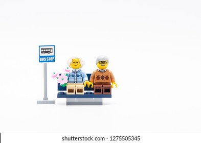 Malaysia, dec 30, 2017. senior man and women with flower sitting waiting a bus.  Lego minifigures are manufactured by The Lego.