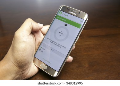 Malaysia - December 8 , 2015:  Hand holding white Samsung S6 Adge Smart Phone with S health App