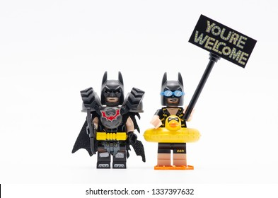 MALAYSIA, feb 16, 2019. lego batman battle ready with vacation batman holding you are welcome sign. Lego minifigures are manufactured by The Lego Group.
