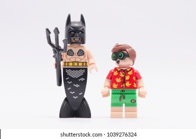 MALAYSIA, feb 18, 2018. mini figure of robin looking at  mermaid batman. Lego minifigures are manufactured by The Lego Group.