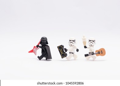 MALAYSIA, feb 18, 2018. mini figure of darth vader holding a guitar with  storm troopers  holding a radio and a guitar. Lego minifigures are manufactured by The Lego Group.