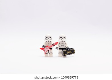 MALAYSIA, feb 18, 2018. mini figure of storm troopers  holding a red guitar and a radio. Lego minifigures are manufactured by The Lego Group.