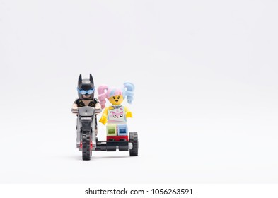 MALAYSIA, feb 18, 2018. mini figure of batman riding dirt bike with n-pop girl. Lego minifigures are manufactured by The Lego Group.