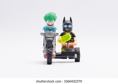MALAYSIA, feb 18, 2018. mini figure of joker and vacation batman riding motorcycle. Lego minifigures are manufactured by The Lego Group.