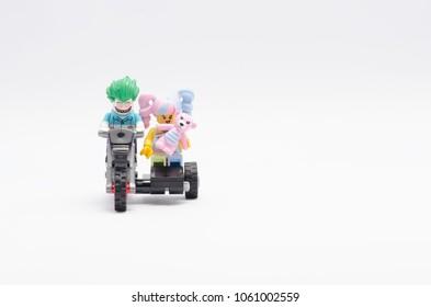 MALAYSIA, feb 18, 2018. mini figure of joker and n-pop girl holding teddy bear riding motorcycle. Lego minifigures are manufactured by The Lego Group.
