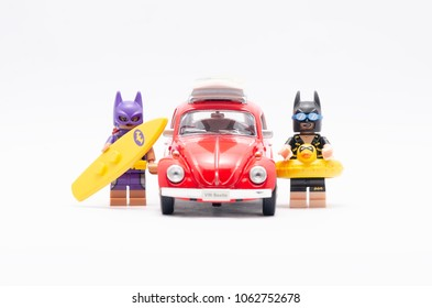 MALAYSIA, feb 18, 2018. mini figure of  bat girl and batman on holiday with volkswagen beetle. Lego minifigures are manufactured by The Lego Group.