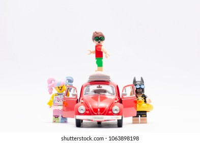 MALAYSIA, feb 18, 2018. mini figure of n-pop girl with batman and robin on top of roof going on holiday with volkswagen car. Lego minifigures are manufactured by The Lego Group.