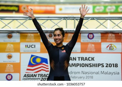 Malaysia, February 16th 2018: Malaysian athlete, Jupha Som Net waves audien after won Gold Medal in Point Race Category during 38th Asian Track Championships 2018 at National Velodrome in Nilai.