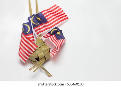 Malaysia flag with dumpling leaf isolated on white background. Traditional food and independence day celebration.