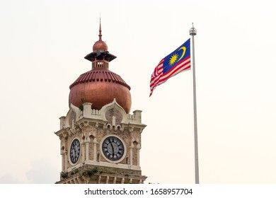 Malaysia Flag Fluttering beside the Sultan Abdul Samad Building Clock Tower