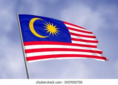 Malaysia flag isolated on sky background. close up waving flag of Malaysia. flag symbols of Malaysia.
