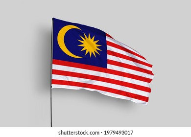 Malaysia flag isolated on white background with clipping path. close up waving flag of Malaysia. flag symbols of Malaysia. Malaysia flag frame with empty space for your text.