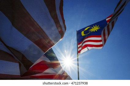 Malaysia flag also known as Jalur Gemilang wave with the blue sky. People fly the flag in conjunction with the Independence Day celebration or Merdeka Day.